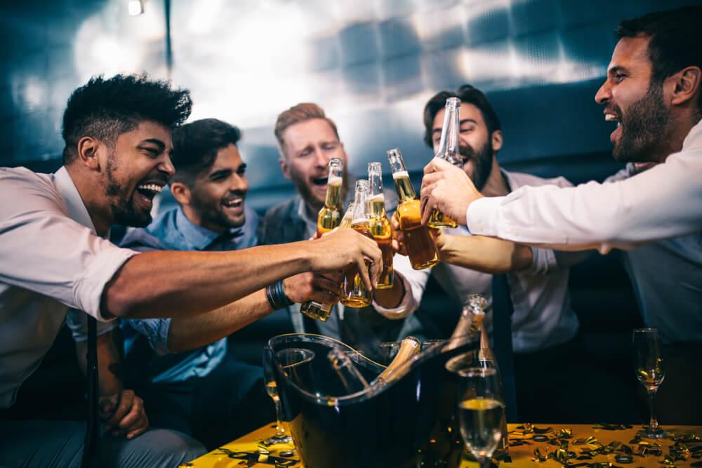 men drinking in a nightclub