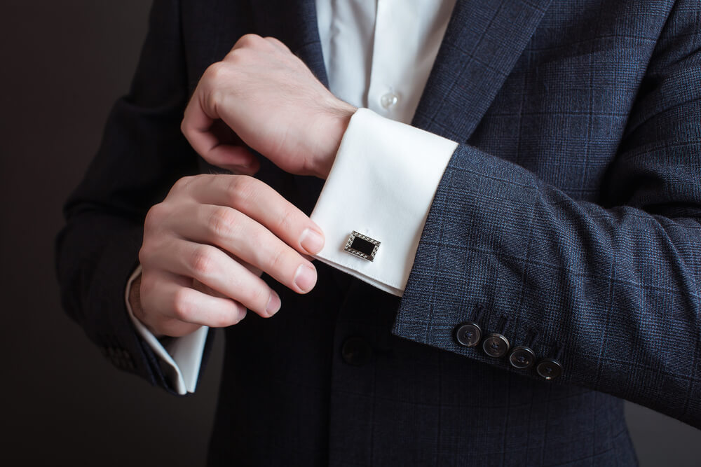 man wearing cufflinks with a suit