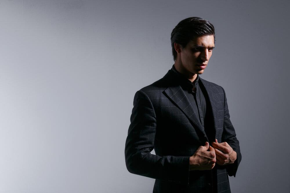 man wearing black suit with black shirt