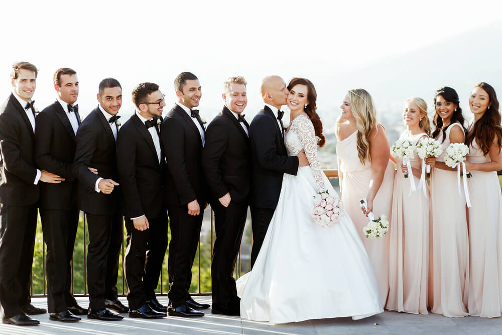 groomsmen in black tie wedding