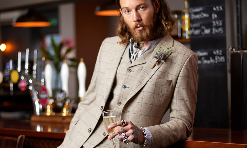 Is a beige suit appropriate for a wedding?