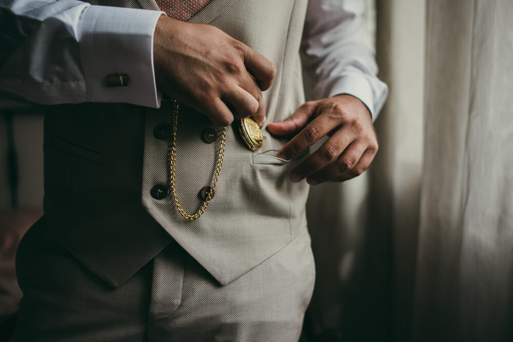 wearing a pocket watch with a waistcoat