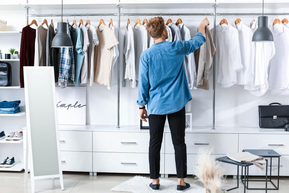 man adding shirt to his wardrobe