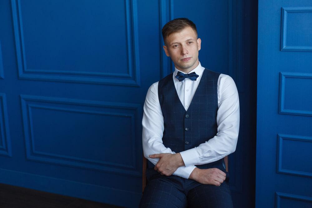 man wearing a blue waistcoat