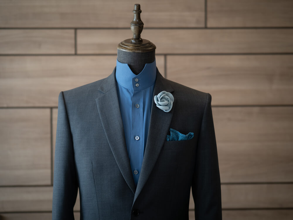 blue shirt with grey suit