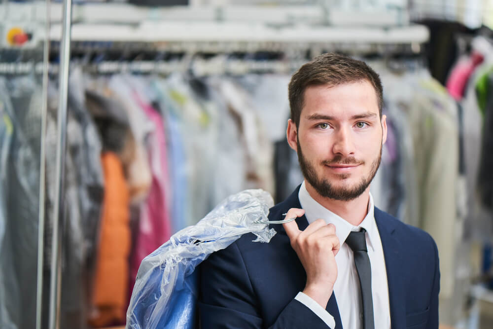 man in suit at dry cleaners