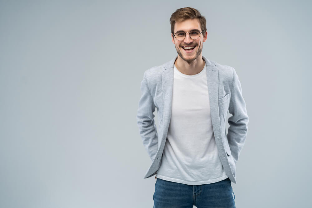 man wearing blazer and jeans