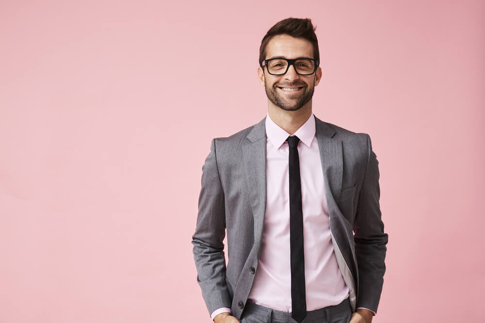 pink shirt with grey suit