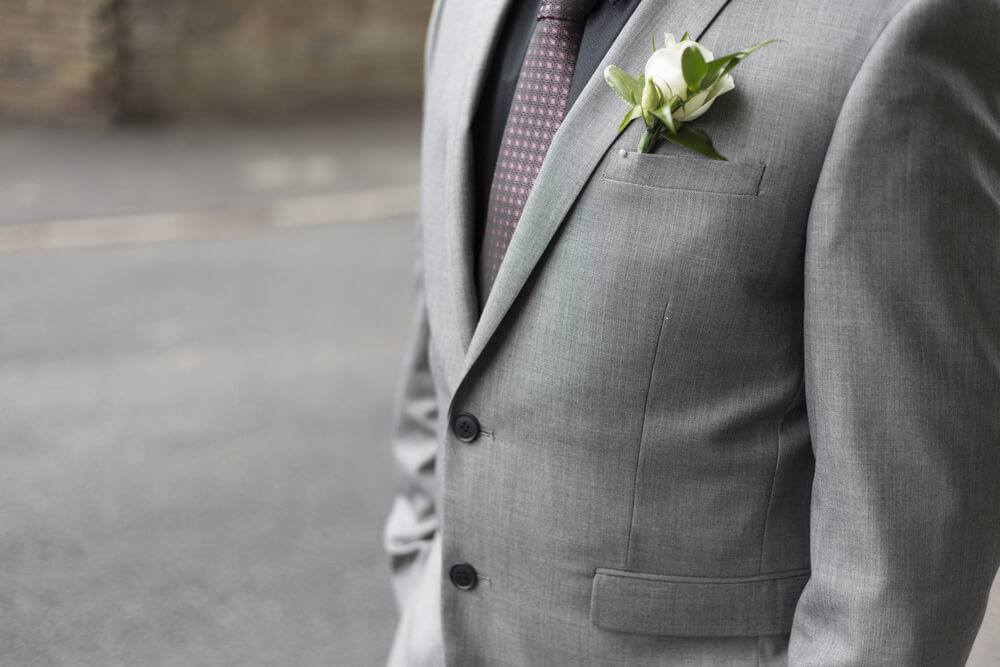 black shirt with grey suit
