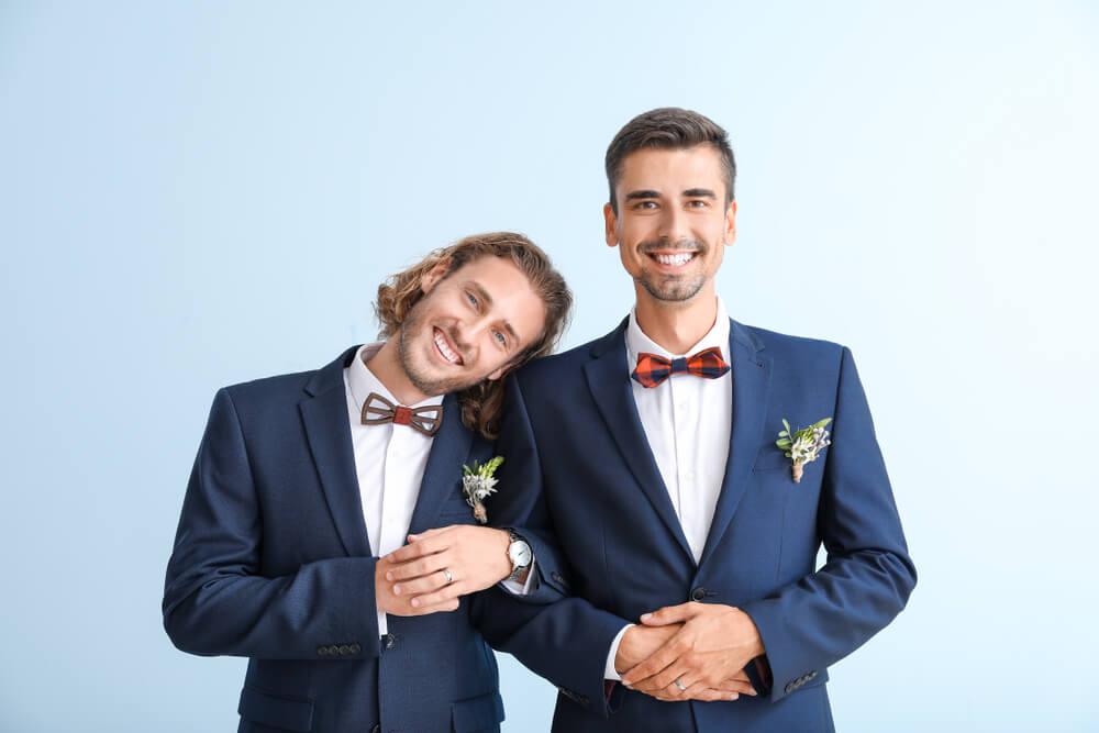 gay couple in suits