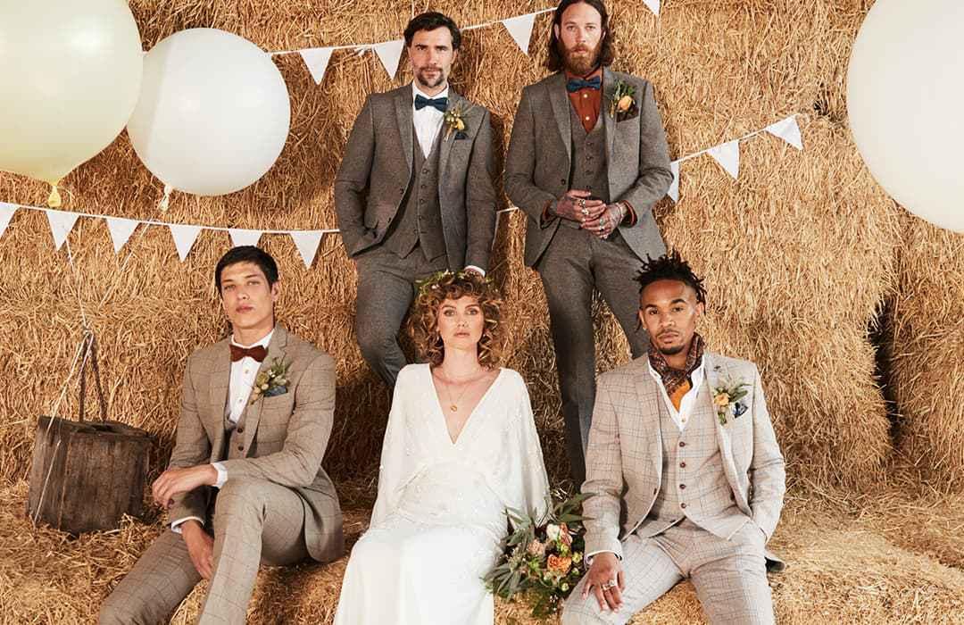 bride with groom and groomsmen in wedding suits